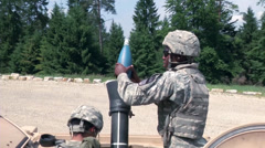 Soldiers from a Mortar Team Conducts Gunnery practice Stock Footage