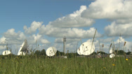 Stock Video Footage of radio telescopes and satellite dishes dolly shot