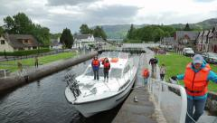 People pull boat through locks at fort augustus, caledonian canal, scotland Stock Footage