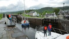 people pull boat through locks at fort augustus, caledonian canal, scotland - stock footage