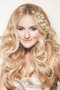 portrait of affectionate blond bride. wedding makeup and hairdo. wedding deco - stock photo