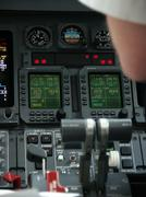 LearJet Instrument Panel and Pilot - stock photo