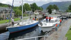 Motorboat, through locks at fort augustus, caledonian canal, scotland Stock Footage