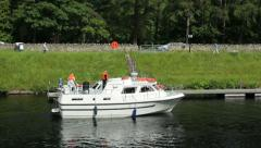 Motor boat comes into loch ness at fort augustus, caledonian canal, scotland Stock Footage