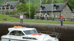 Tilt as people hold boat in locks at fort augustus, caledonian canal, scotlan Stock Footage