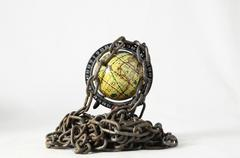 Earth globe close in chain. 3d... Stock Photos
