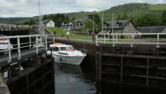 Lock gates open at fort augustus, caledonian canal, scotland Stock Footage
