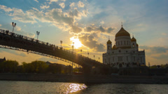 Cathedral of Christ  Saviour and Patriarshy Bridge in Moscow on a sunset Stock Footage