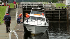Holiday boat accident as it gets stuck on sill as water goes down in lock Stock Footage