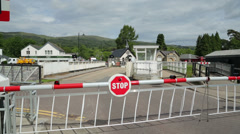 Road swing bridge opens to let boats pass, fort augustus, scotland Stock Footage