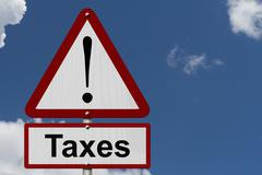 Taxes caution sign Stock Illustration