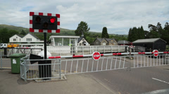 Road swing bridge closes to let cars pass, fort augustus, scotland Stock Footage