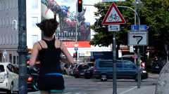 Downtown Munich traffic Jogger jogging 3D Movie Bill board Transformers Age of Stock Footage