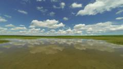 Clouds move reflected in the water Stock Footage