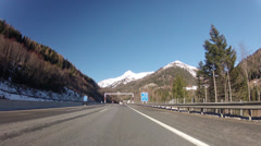 Driving on highway through tunnel in Austrian Alps - stock footage