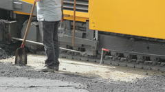 Road paving machine is laying asphalt, close up Stock Footage