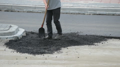 Shoving asphalt on the street, closeup Stock Footage