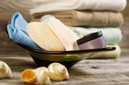 Stock Photo of spa hygiene accessories in glass bowl on rustic wood