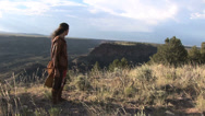 Stock Video Footage of Native American Looks At Land 1 in series( release on file)