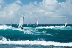 Windsurfers in windy weather on maui island Stock Photos