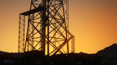 Drill Tower At Sunrise. Oil Rig Industry Drilling Derrick - stock footage