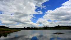 Movement of clouds over the reservoir. Donetsk, Ukraine, Full HD Stock Footage
