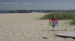 Single pinwheel on the beach in Cape Cod during the day. Stock Footage
