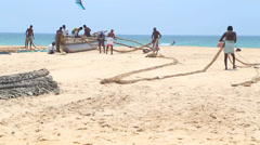 View of a fishermen working on Hikkaduwa beach. Stock Footage