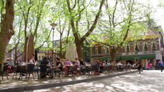 people eating lunch on outside terrace in holland - stock footage