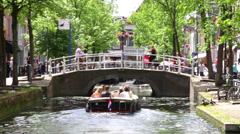 dutch canal, with boat, bikes, and bridge - stock footage