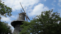 Traditional dutch windmill in holland with pan Stock Footage