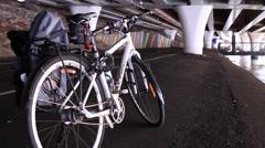 Bicycle under highway Stock Footage