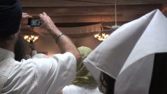 Sikhs with Smartphones Stock Footage