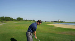 Golf Professional Lining Up Shot Fairway - stock footage
