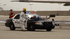 Airport fireman carry victim on police car Stock Footage