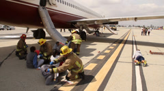 Firemen give first aid at plane crash exercise Stock Footage