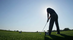 Male Caucasian Golfer Driving Off Fairway - stock footage