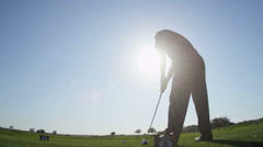 Male Caucasian Golfer Driving Off Fairway Sun Lens Flare - stock footage