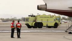 Airport firetruck driving on tarmac with foam - stock footage