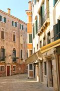 House on a narrow street in the italian city of venice, italy Stock Photos
