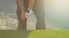 Golfer Leaving Sand Bunker After Successful Shot - stock footage