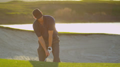 Male Golfer Playing Out Sand Bunker - stock footage