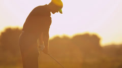 Male Caucasian Golfer Practicing Swing Silhouette Stock Footage