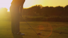 Stock Video Footage of Vacation Golfer Sunset Teeing Off