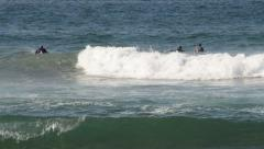 Surfers Riding Waves in the Indian Ocean Stock Footage