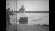 Military men arriving at harbour in a land vehicle Stock Footage