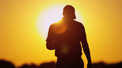 Golfer Silhouette Setting Sun Background Stock Footage