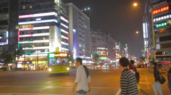 Pedestrian cross dunhua street at night Stock Footage
