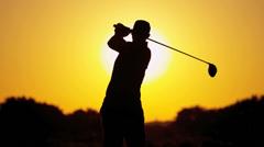 Male Golfer Sunset Silhouette Following Shot - stock footage