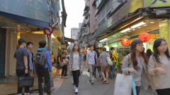 Shida students buy drinks in market area Stock Footage